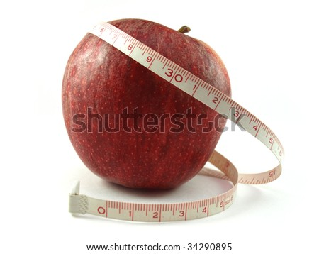 Healthy apple and measuring tape