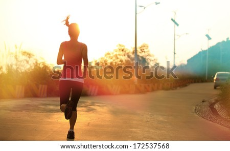 healthy asian woman runner running outdoor under sunrise