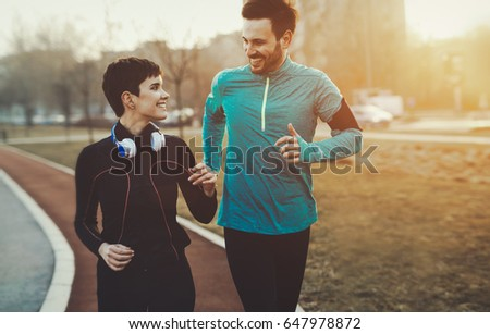 Healthy athletic couple jogging and running outdoor together #647978872