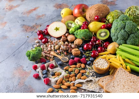 Healthy balanced dieting concept. Selection of rich fiber sources vegan food. Vegetables fruit seeds beans ingredients for cooking. Copy space background #717931540
