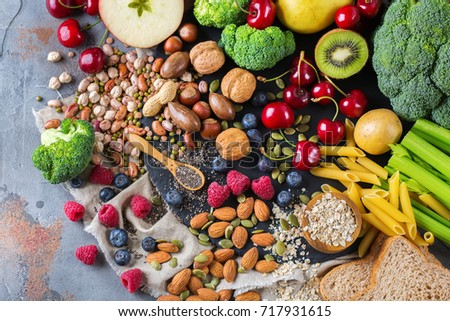 Healthy balanced dieting concept. Selection of rich fiber sources vegan food. Vegetables fruit seeds beans ingredients for cooking. Top view flat lay #717931615