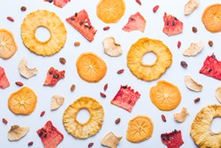 Healthy balanced food, clean eating, naturally flavoured snacks, transparent ingredients concept. Dried fruits, dehydrated persimmon, watermelon, pineapple, apple chips on a white background