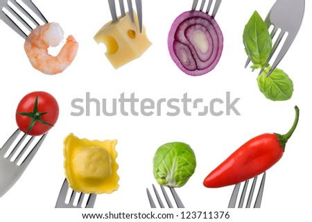 healthy balanced food on forks in a border with copy space isolated against white