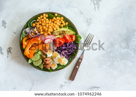 Healthy balanced vegetarian food concept, buddha bowl salad. Avocado, spinach, chickpeas, vegetable appetizer plate