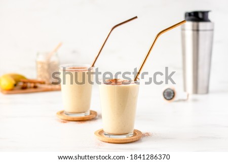 Healthy Banana Smoothie Shake with Protein Powder. Protein Shake. Protein Smoothie. Banana Bread Smoothie with Protein Powder. Fresh and Nourishing Smoothie.