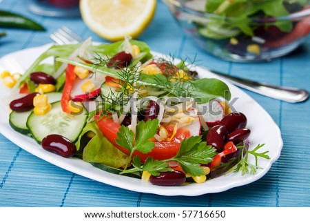Healthy beans and vegetables salad on white plate