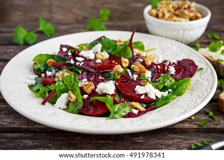 Healthy Beet Salad with fresh sweet baby spinach, kale lettuce, nuts, feta cheese and toast melted