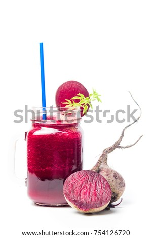 Healthy beet smoothie in a jar isolated on white