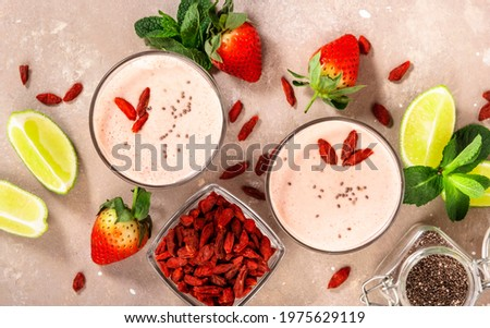 Healthy blended diet smoothie drink with strawberry and goji berries, chia seeds and lime. Top view Stock foto ©