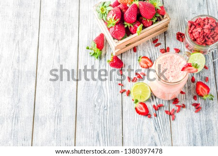 Healthy blended drink. Organic diet smoothie with lime, strawberry and goji berries, wooden background copy space #1380397478