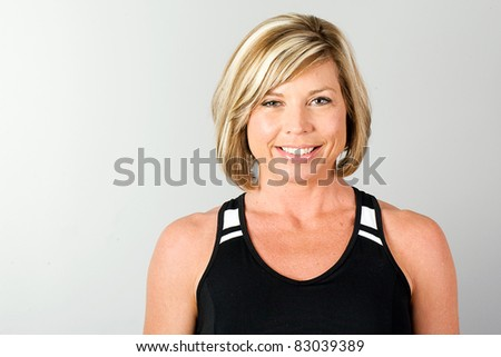 Healthy, blond, mature woman in workout clothes.