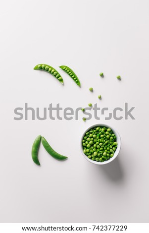Healthy bowl of green pea on white background. Top view with copy space. #742377229