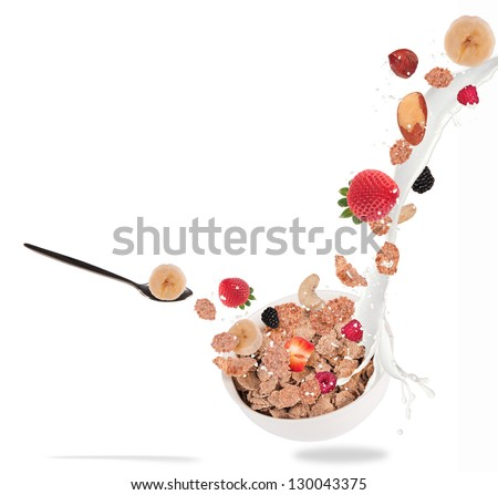 Healthy bowl with flying cereals and fruit, isolated on white background