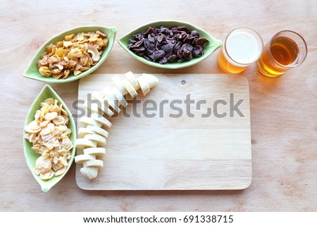 Healthy breakfast concept with banana and corn flakes 