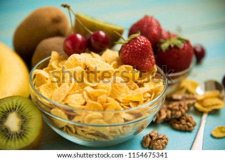 Healthy Breakfast-Cornflakes and fruits. Corn Flakes. Tasty cornflakes with fruits #1154675341