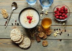 Healthy breakfast. Crispbread, raspberries and honey on the table, wooden background