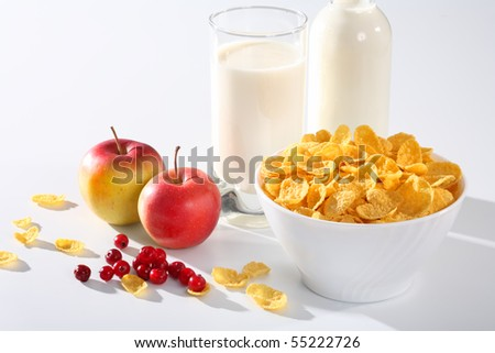 Healthy breakfast (milk with corn flakes) and apples