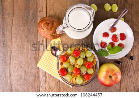 Healthy breakfast on wooden table, upper view