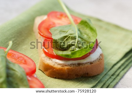 Healthy breakfast, sandwich with cream cheese, tomato and spinach