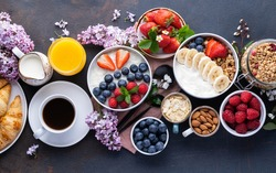 Healthy breakfast set on black background. The concept of delicious and healthy food. Top view, copy space.