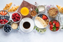 Healthy breakfast set on grey background. The concept of delicious and healthy food. Top view, copy space.
