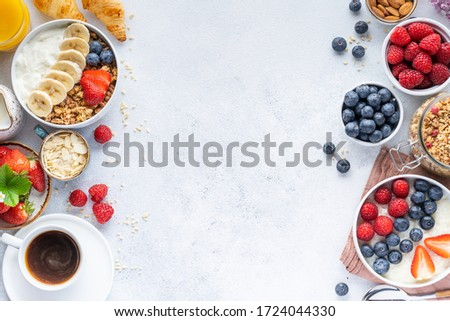 Healthy breakfast set on grey background. The concept of delicious and healthy food. Top view, copy space. Photo stock ©