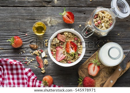 Healthy breakfast. Strawberry granola with almond petals and fresh berries. Served  milk, honey  mint. Top view #545978971