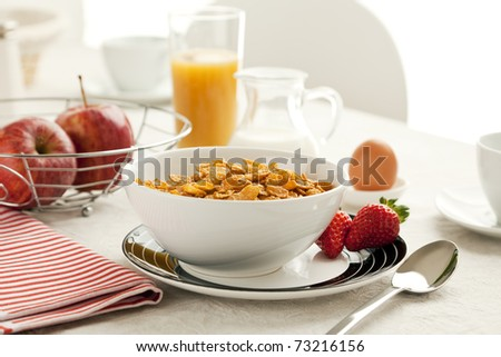 healthy breakfast with cereal flakes, apples, orange juice