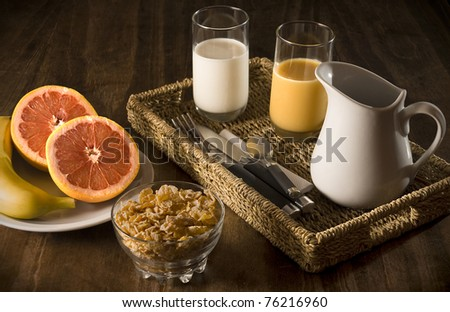 Healthy breakfast with fruit, cereals and milk.