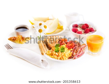 healthy breakfast with scrambled eggs, juice and fruits on white background