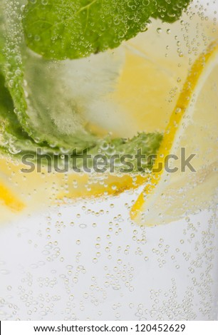 Healthy club soda with lemon and mint background