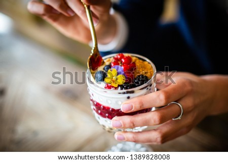 Stock Photo healthy collocated yogurt with fruits on a wood table