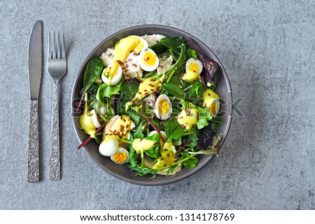 Healthy colorful salad bowl. Salad with chicken breast, quail eggs and flaxseeds. Concept of healthy or dietary food. Superfoods Eco food. Fitness food. Keto diet recipe. #1314178769