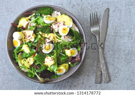 Healthy colorful salad bowl. Salad with chicken breast, quail eggs and flaxseeds. Concept of healthy or dietary food. Superfoods Eco food. Fitness food. Keto diet recipe. #1314178772