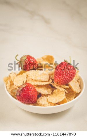 healthy concept with strawberry and flakes/strawberry and flakes in white bowls on a marble background. Selective focus #1181447890
