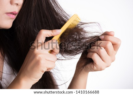 Healthy concept. Woman show her brush with damaged long loss hair and looking at her hair. Photo stock ©
