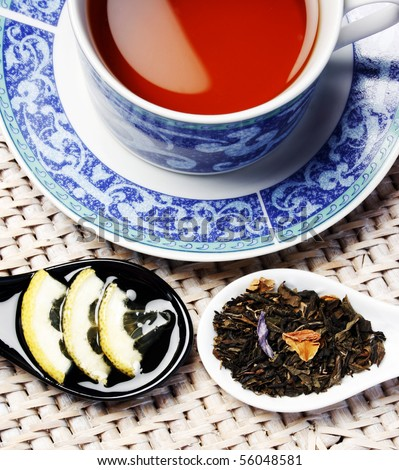 Healthy cup of tea arrangement with honey, lemon and herbals