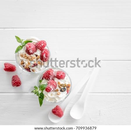 healthy dessert. Granola with yoghurt and raspberry