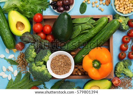 Healthy diet concept. Olives, lettuce, tomato, chickpeas, buckwheat on summer background. Space for text #579801394