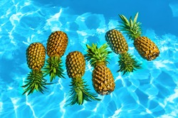Healthy Diet Food. Fresh Raw Organic Ripe Pineapples Floating In Pure Water In Swimming Pool. Juicy Fruits. Nutrition And Lifestyle. Eating Vitamins For Beauty And Health. Go Vegan, Hydration Concept