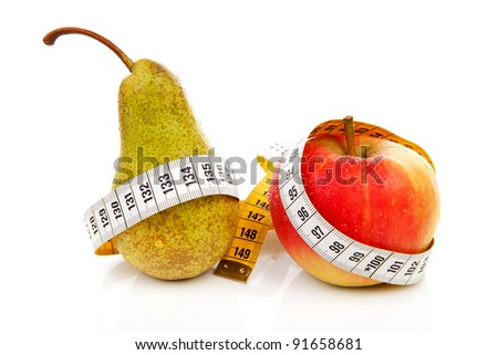 healthy diet; pear and apple with measure tape over white background