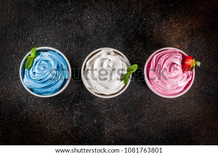 Healthy diet summer dessert, vanilla and berry frozen yogurt or  soft ice cream in white bowls, white marble background copy space above #1081763801