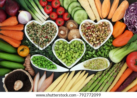 Healthy diet superfood concept with fresh vegetables loose and in heart shaped and curved bowls with food high in antioxidants, anthocyanins, vitamins, minerals and dietary fiber. #792772099
