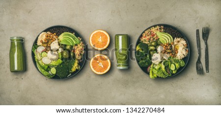 Healthy dinner, lunch setting. Flat-lay of vegan superbowls or Buddha bowls with hummus, vegetable, salad, beans, couscous, avocado and green smoothies in bootles, top view. Clean eating food concept