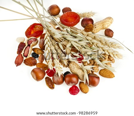 Healthy dried fruit and nuts with the spikelet of oats and wheat ...