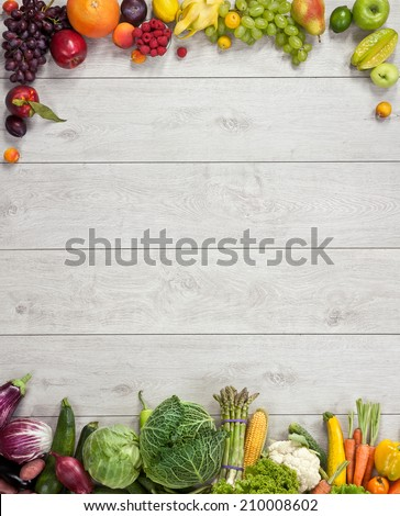 Healthy eating background / studio photography of different fruits and vegetables on wooden table