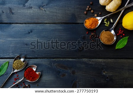 Healthy eating Background with herbs and spices selection on dark wooden table. Food or cooking concept, top view.