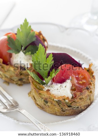 Healthy eating: baked, no fat version of potato pancakes served with vegetables.