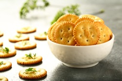 Healthy eating diet food- fresh  cheese cracker biscuits served in white bowl.
