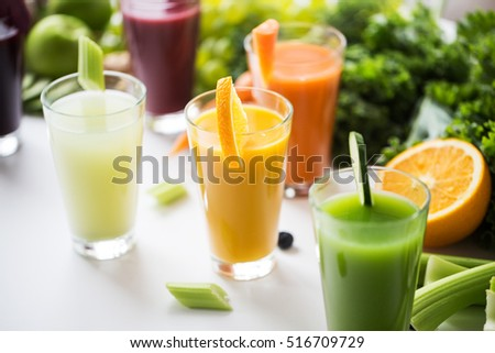 Shutterstock healthy eating, drinks, diet and detox concept - glasses with different fruit or vegetable juices and food on table